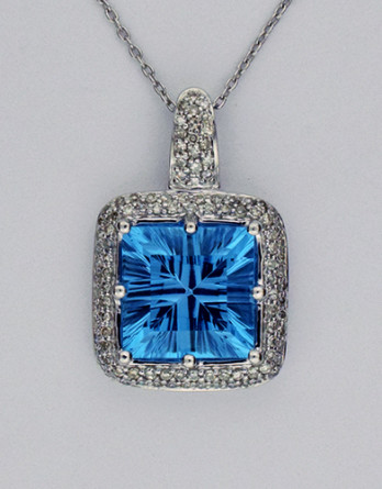 "14kt White Gold Pendant With a 7.00 ct Blue Topaz & .46ct in ""G-H"" SI1-SI2 Diamonds on a 18"" 14kt White Gold Chain"